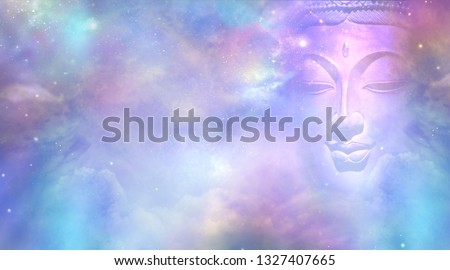 Cosmic Buddha Vision Cloud scape - Semi transparent Buddha face with closed eyes amongst the celestial heavens providing a beautiful  pink and blue sky background    #1327407665