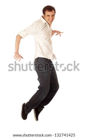 Casual young man jumping. Studio shot over white. #132741425