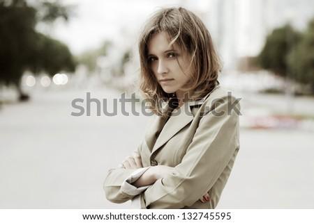 Sad young woman on a city street #132745595
