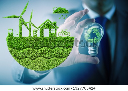 Businessman in ecological green concept #1327705424