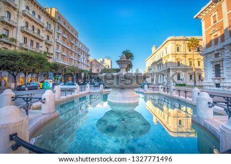 Bari, Puglia, Italy - Fountain Fontana Corso Cavour and Theater Teatro Petruzzelli . The capital of Apulia region, a big city on the Adriatic sea #1327771496