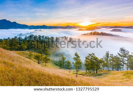 The sun rises with beautiful colors at highland in Da Lat - Viet Nam Royalty-Free Stock Photo #1327795529