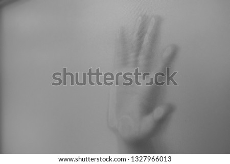 Hands that are behind the glass #1327966013
