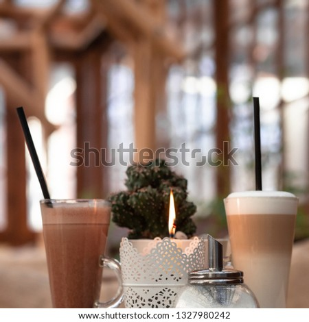 Cozy warm cafe in beige and brown tones. Wooden table. Restaurant menu in the cover of wood.   #1327980242