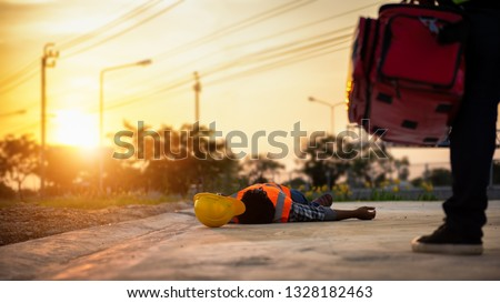 Accident at work of construction labor people, Basic First aid and CPR Training at outdoor. Heat Stroke or Heat exhaustion in body concept. #1328182463