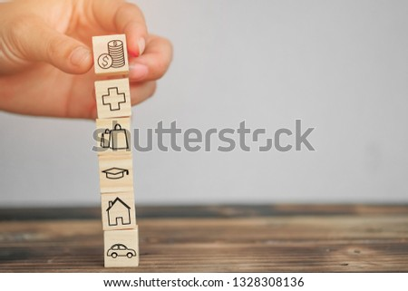 Wood block stacking as step stair and coins stacked, business growth to success.Startup concepts with business strategy symbols on wooden cubes - Risk management. #1328308136