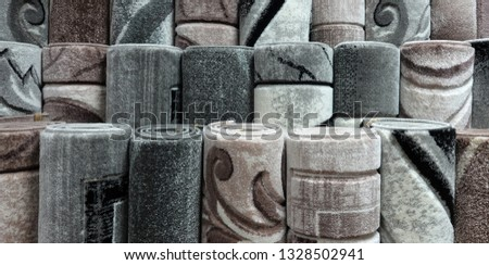 Carpets variety selection rolled up grey long rugs shop store #1328502941
