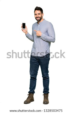 Full-length shot of Elegant man with shirt happy and pointing the mobile on isolated white background #1328503475