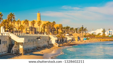 Monastir in Tunisia is an ancient city and popular tourist destination with a beach on the Mediterranean Sea. #1328602211