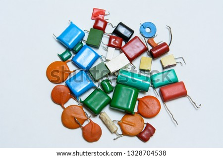 Different type capacitors in different colors. Ceramic,metal, film capacitors. On white background #1328704538