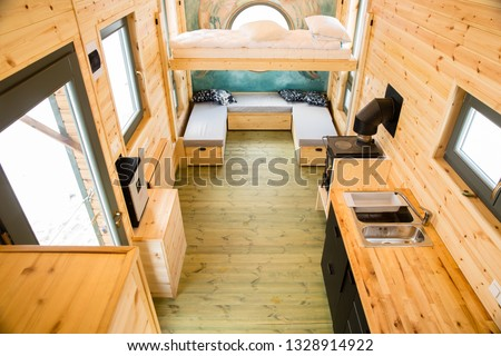 Mobile tiny house interior. Great for outdoor experiences and wildlife. Lots of space and pure adventure. No need for special authorizations, only a decent car to pull this tiny house and off you go. Royalty-Free Stock Photo #1328914922