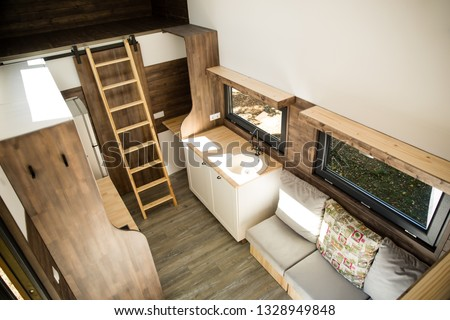 Mobile tiny house interior. Great for outdoor experiences and wildlife. Lots of space and pure adventure. No need for special authorizations, only a decent car to pull this tiny house and off you go. #1328949848