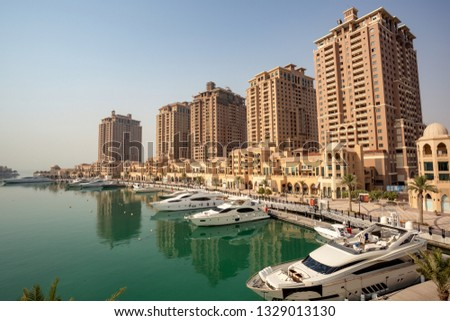 DOHA, QATAR – SEPTEMBER 06 2013: Mediterranean-style towers in Porto Arabia, The Pearl Qatar. #1329013130