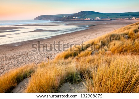 Sunset on the beautiful beach at Croyde on the North Devon Coast England UK Royalty-Free Stock Photo #132908675