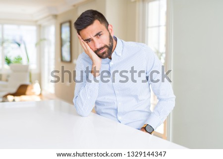 Handsome hispanic business man thinking looking tired and bored with depression problems with crossed arms. #1329144347