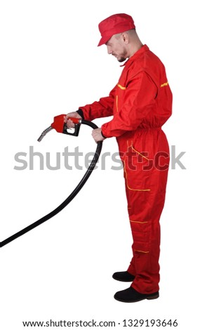 Man gas station staff  is holding red gasoline pistol pump fuel nozzle #1329193646