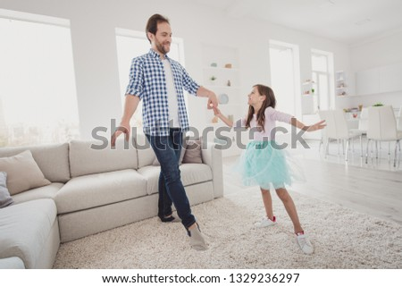 Full length body size view of nice cool fashionable attractive cheerful talented elegant pre-teen girl learning practicing training moves with dad coach trainer in modern light white interior room #1329236297