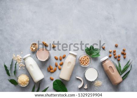 Various vegan plant based milk and ingredients, top view, copy space. Dairy free milk substitute drink, healthy eating. #1329259904