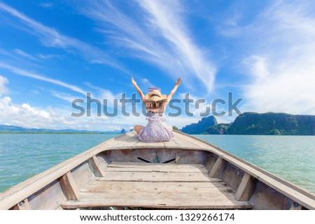 Women sit on the boat at Phang Nga Bay Thailand #1329266174