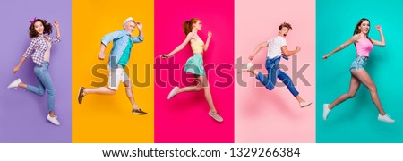 Full size body length view portrait of cheerful cheery glad dreamy sporty people in a striped T-shirt overalls activity lifestyle dream isolated on different color bright vivid shine background Royalty-Free Stock Photo #1329266384