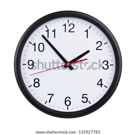 Round office clock shows five minutes to two #132927782