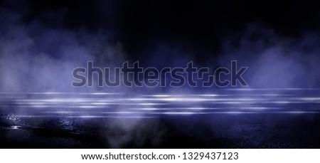 Wet asphalt, reflection of neon lights, a searchlight, smoke. Abstract light in a dark empty street with smoke, smog. Dark background scene of empty street, night view, night city. #1329437123