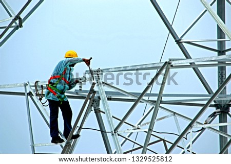NAGPUR-INDIA-JUNE 23 :  The worker assembly steel part of steel tower for tower load test at work-site, June 23, 2015 Nagpur Province, India #1329525812