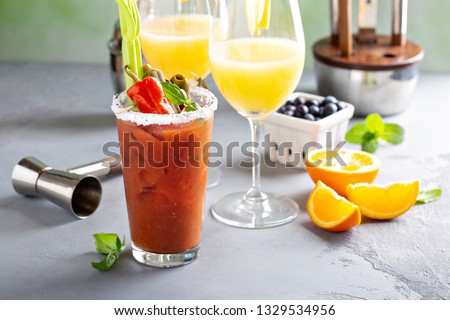 Brunch cocktails with orange mimosas and bloody mary #1329534956