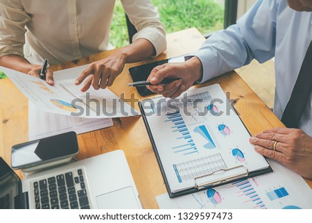 Business advisor analyzing financial figures denoting the progress Internal Revenue Service checking document. Audit concept #1329597473