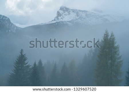 First winter snow in Cortina, Dolomites, a ski resort in northern Italy, view from ski resort hotel balcony with balcony's fence foreground. #1329607520