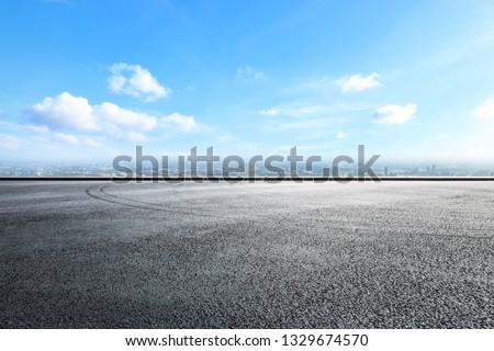 Empty asphalt road ground over modern city #1329674570