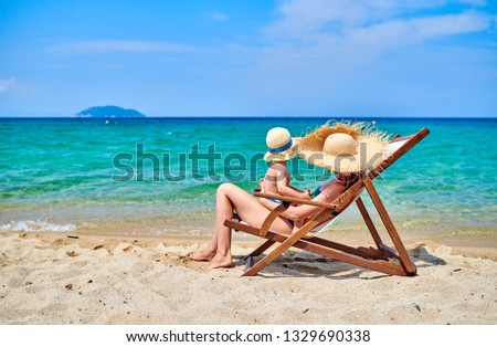 Two year old toddler boy on beach with mother. Summer family vacation. Sithonia, Greece.  #1329690338