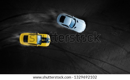 Aerial top view two cars drifting battle on race track, Two race cars view from above. #1329692102