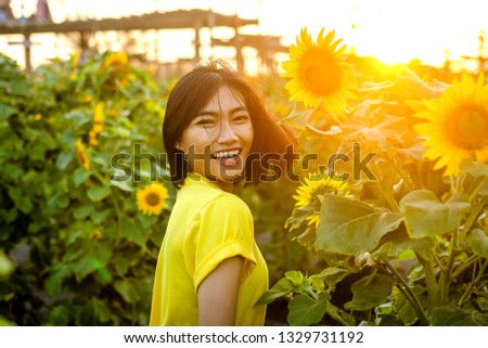 Asian women on the sunflower garden during the summer #1329731192