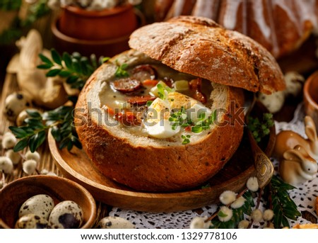 Easter soup, The sour soup (Żurek) made of rye flour with smoked sausage and eggs served in bread bowl. Traditional polish sour rye soup, popular Easter dish #1329778106