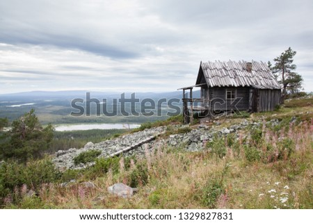 Old Santa Claus house on the top of Levitunturi fell on autumn. This cabin is near of ski slopes and it is very popular place for tourist to take photos while skiing or hiking #1329827831