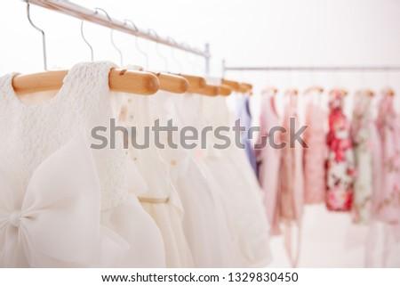 White dresses hung on hangers #1329830450