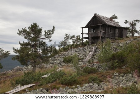 Beautiful old wooden cottage on the top of Levitunturi fell on autumn. This cabin is near of ski slopes and it is very popular place for tourist to take photos #1329868997