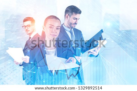 Attractive young businesswoman giving documents, man in glasses reading papers and businessman with clipboard standing together in city. Forex graph foreground. Toned image double exposure #1329892514