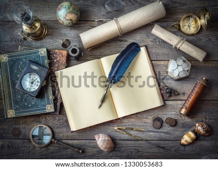 Columbus Day, exploration and nautical theme vintage background. Globe, telescope, lamp, divider, old coins, shell, map, shell, book, compass, hourglass, quill pen on wood desk.  #1330053683
