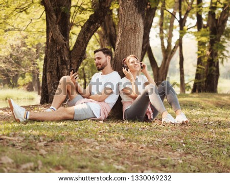 Young couple Man and woman relaxing and enjoy with love mood in park summer time  #1330069232