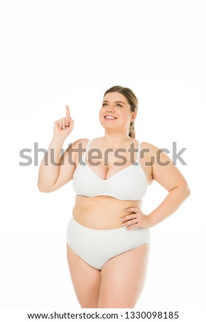 smiling overweight girl in underwear showing idea sign isolated on white, body positivity concept  #1330098185