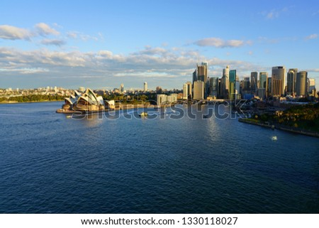 SYDNEY, AUSTRALIA -13 JUL 2018- View of the Sydney Opera seen from the Sydney Harbour Bridge at sunset in the Sydney Harbour in New South Wales, Australia. #1330118027