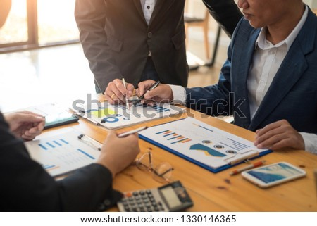 Group of business people meeting communication discussion about analyzing data financial report in office. Accounting concept. #1330146365