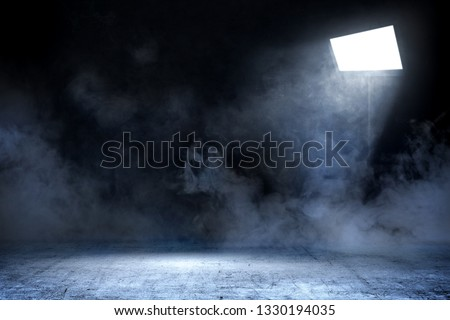 Room with concrete floor and smoke with light from spotlights against dark wall background