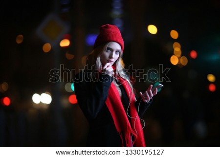 Beautiful young girl with smartphone #1330195127