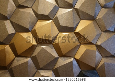 Hexagonal with hidden polygon effect wall design with gold shades of colour presenting luxury and modern trendy element