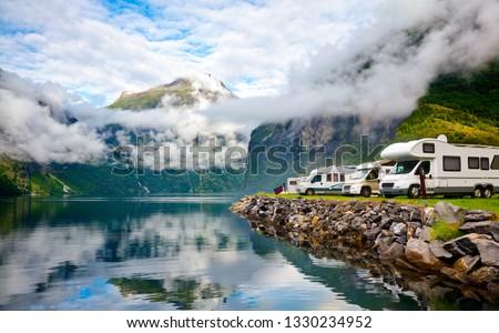 Camper van recreational vehicles (RV) parked at norwegian campsite on a fjord coast, Norway, Scandinavia #1330234952