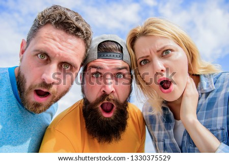 Amazed surprised face expression. How to impress people. Shocking impression. Men with beard and woman looking shocked. No way. Friends shocked faces looking at you. That is impossible. Shocking news. #1330375529