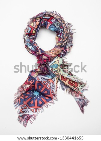 Multicolor scarf on white background. Top view. #1330441655